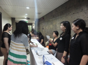 Participants registering for the talk with the MLAC team members assisting them.