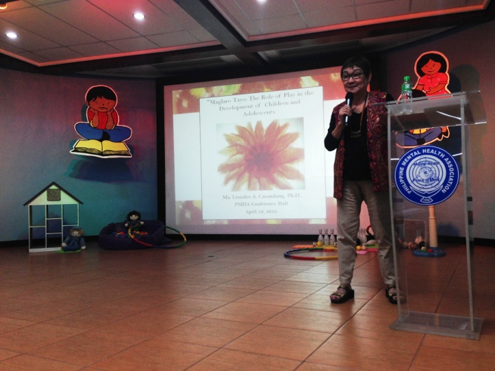 Dr. Carandang giving a talk on Play Therapy.