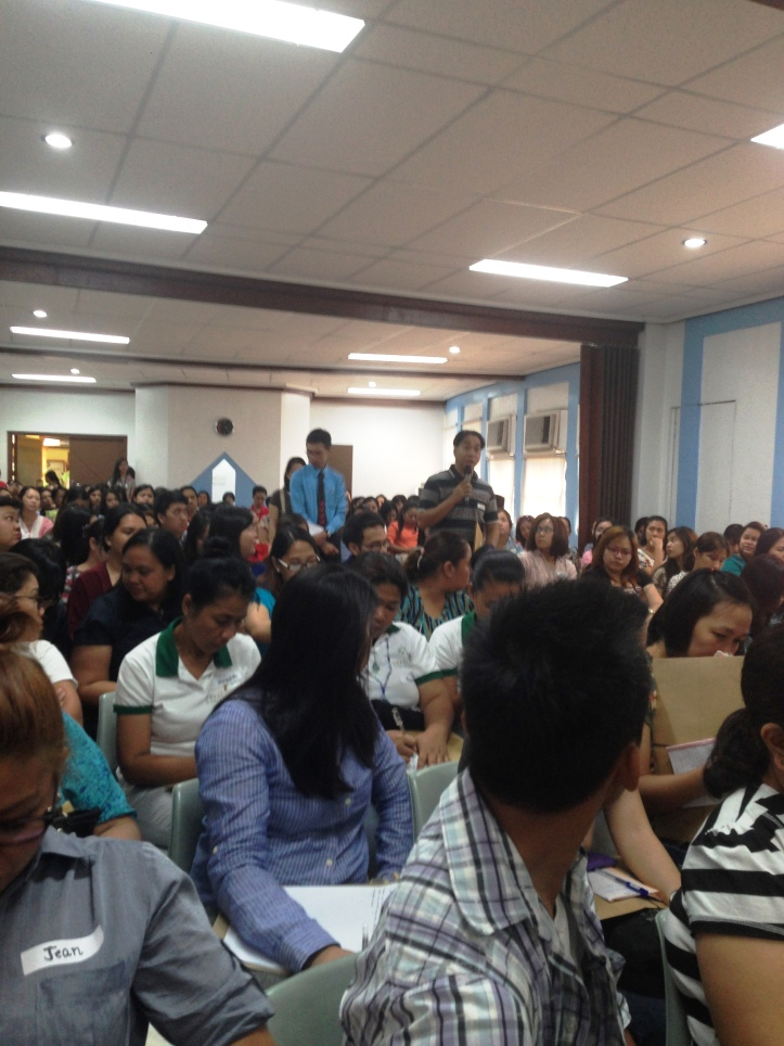 The participants exceeding the seating capacity of the conference hall.