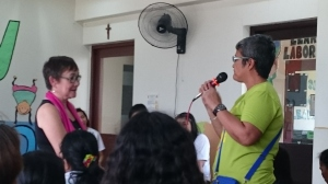Dr. Carandang listening to a participant sharing about her ways of self-care during the open forum.