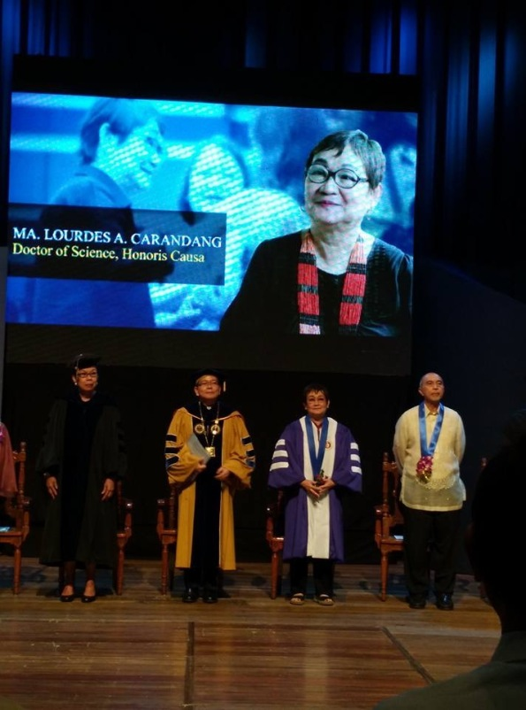 Dr. Honey Carandang with CHED chairperson Dr.Patricia Licuanan, ADMU president Fr. Jett Villarin, and fellow awardee Ed Garcia.